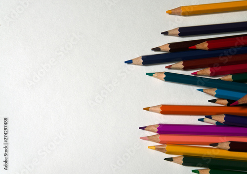 Colored pencils on white background. Office, school supplies. Artistic concept.