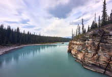 The Turquoise Water Of The Athabasca River Immediately After The Falls