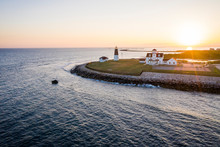 Point Judith Lighthouse And Coast Guard Station At Sunset Aerial