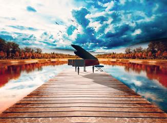 Fototapeta Molo Piano en la naturaleza.Paisaje surreal de arboles y lago.Concepto de música relajada y tranquila de piano