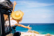 Travel And Freedom Concept With Happiness And Joy - People In Summer Holiday Vacation - Woman Outside The Car In Front Of A Scenic Beautiful Beach And Blue Ocean - Tourism And Wanderlust
