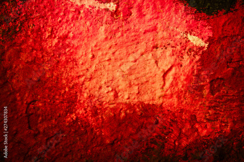 Abstract background in red shades on a very rough and textured background.