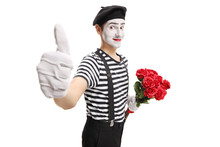 Mime Holding A Bunch Of Red Ro...