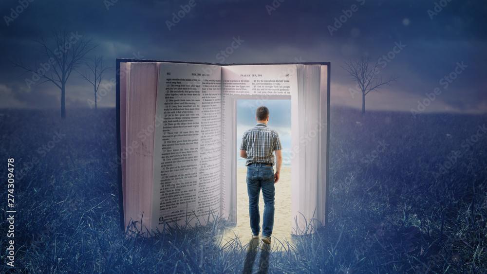 Fototapeta Der Dunkelheit durch eine Bibel entfliehen