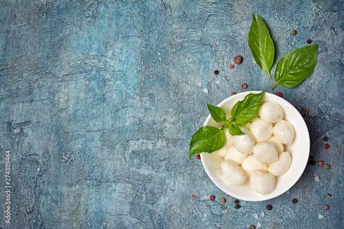Fototapeta Small balls mozzarella cheese with basil obraz