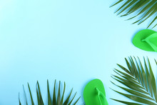 Green Palm Leaves With Accessories And Clothing Items Or Summer Symbols, Beachwear On Colored Paper Textured Background With A Lot Of Copy Space For Text. Top View, Flat Lay.