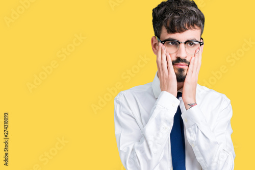 Young handsome business man wearing glasses over isolated background