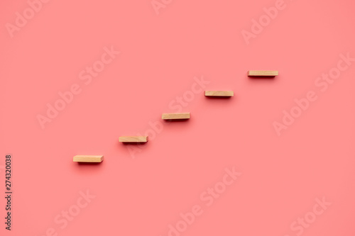 Fotografie, Obraz  Five wooden pegs form a staircase