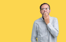Handsome Middle Age Elegant Senior Man Wearing Glasses Over Isolated Background Bored Yawning Tired Covering Mouth With Hand. Restless And Sleepiness.