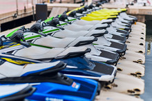 DENIA, SPAIN - JUNE 13, 2019: Many Jet Skis Are Parked At The Pier.