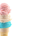 Red White And Blue Scoops Of Ice Cream On A Cone On A White Background