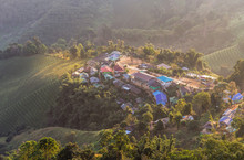High Aerial View Sunrise With White Fog  In Early Morning At Doi Mae Salong Village Doi Mae Salong, Chiang Rai, Thailand