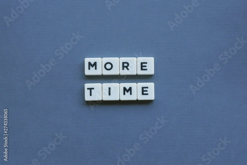 Fotografie, Obraz  ' More Time ' word made of square letter word on grey background.