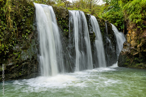 Photo Waterfalls and Green Pond - Strong and broad waterfalls flowing into a clear green pond in Puaa Kaa State Wayside Park at side of the Road to Hana Highway, Maui, Hawaii, USA