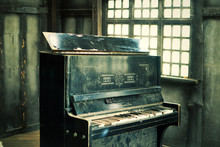 The Old Broken Piano In The Wo...