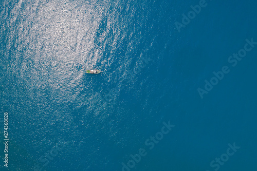 Leinwand Poster Aerial View Of Boat In Deep Blue Sea Water, Gelendzhik, Russia