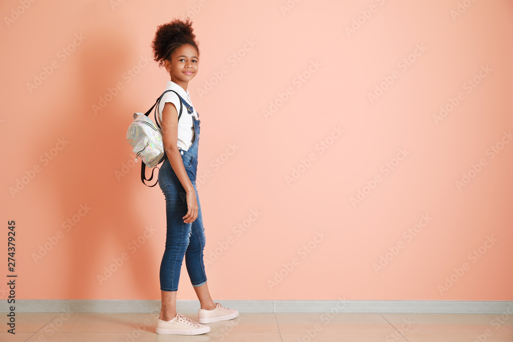 Fototapety, obrazy: Stylish African-American girl in jeans overall near color wall