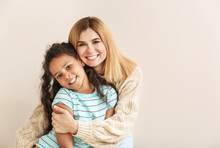 Happy Woman With Little Adopted African-American Girl On White Background