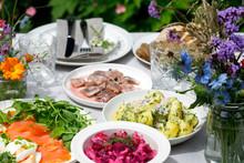 Scandinavian Midsummer Feast With Potato Salad, Herring, Salmon And Beetroot