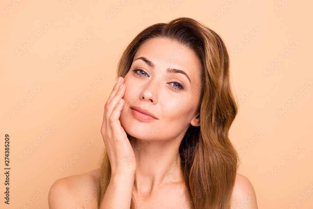 Fototapeta Close up photo beautiful amazing mature she her lady overjoyed after salon spa procedures aesthetic pretty ideal appearance nude arm hand palm touch cheek perfection isolated pastel beige background