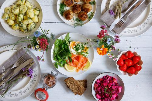 Fotografia, Obraz Scandinavian midsummer feast with potato salad, meatballs, salmon and beetroot