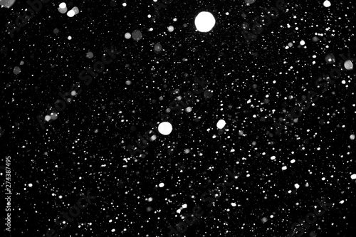 snow on a black background, snowfall, white spots on a black background - 274387495