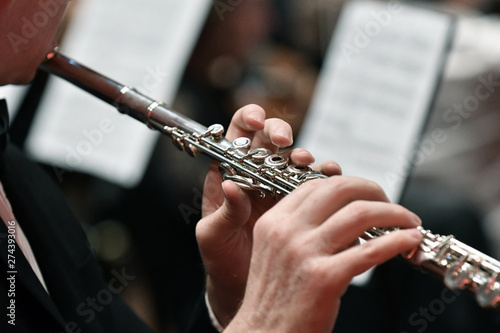 Fotografie, Obraz  Close up tight shot of hand playing flute