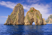 The Faraglioni Rocks On The Coast Of The Island Of Capri, Italy. Capri Stacks, The Symbol Of The Island, Located In The Gulf Of Naples, Campania.