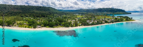 Port Orly sandy beach with palm trees, Espiritu Santo Island, Vanuatu. - 274396895