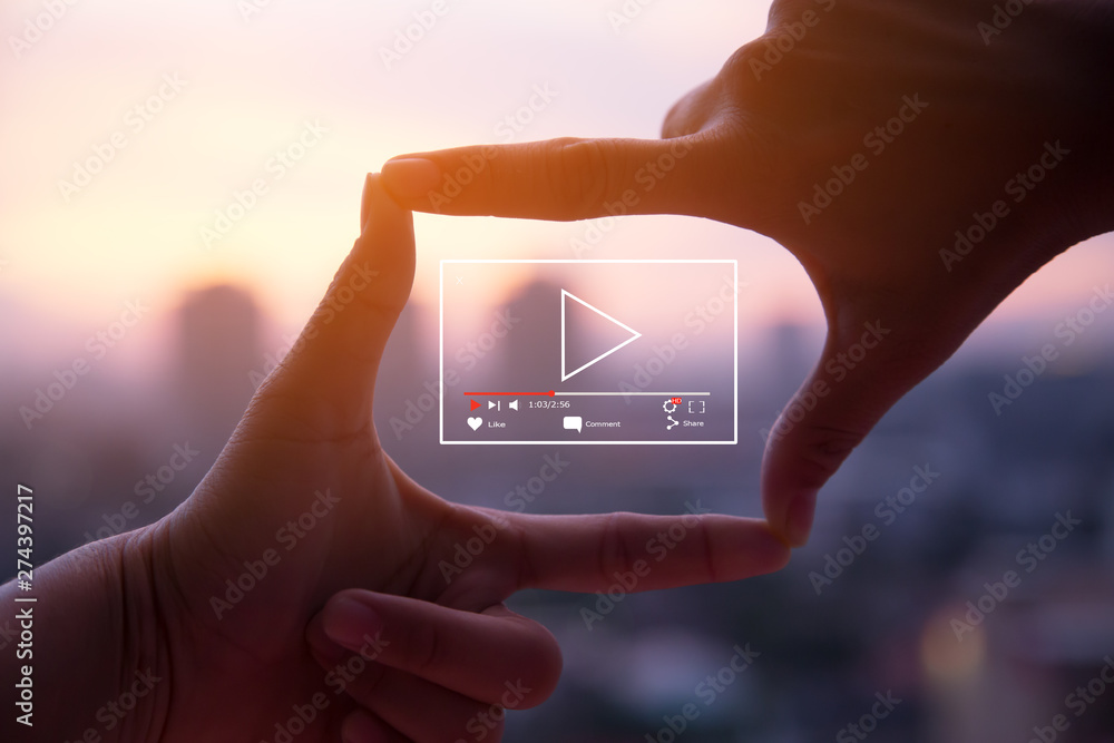 Fototapety, obrazy: Online live video marketing concept.Photo sign made by human hands on blurred sunset sky as background