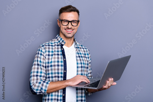 Close up photo handsome attractive he him his cheer guy hands arms hold notebook writing checking letters colleagues partners stylish look wear casual plaid checkered shirt isolated grey background - 274406233