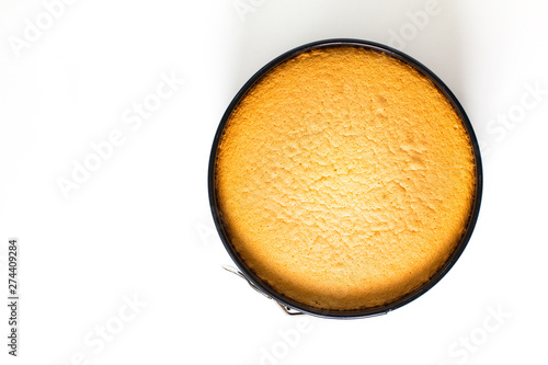 Baking food concept fresh baked homemade sponge cake in cake pan on white backgr Wallpaper Mural
