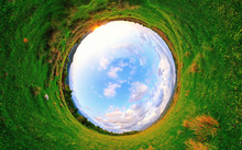 Stereographic Panoramic Projection Of A Green Field In The Summer. 360 Degree Panorama.