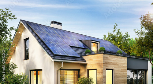 Obraz Solar panels on the gable roof of a modern house - fototapety do salonu