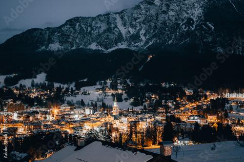 Poster de jardin Noir Scenic night view over Cortina d'Ampezzo in winter. Cortina d'Ampezzo is located in Dolomites, Italy.