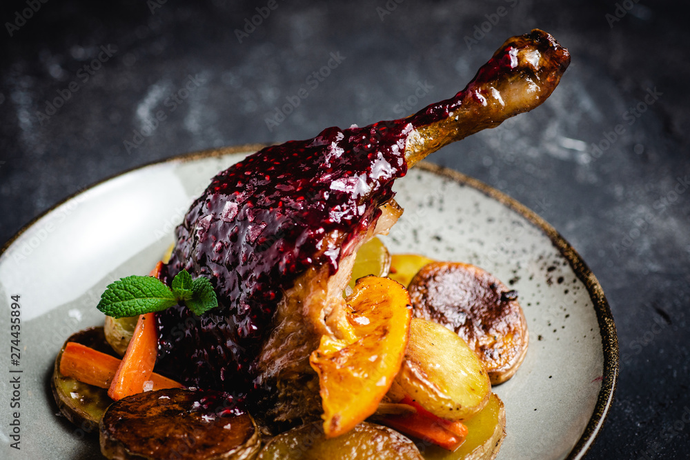 Fototapety, obrazy: Roasted Goose Leg with Potatoes, Carrots and Oranges