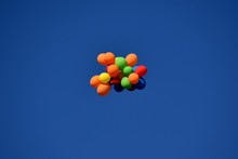 A Cluster Of Multicolored Balloons Flies Into The Sky
