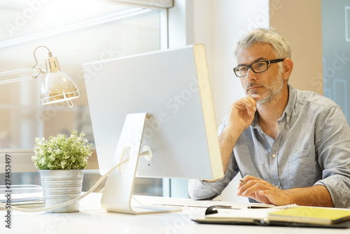 Smart casual businessman working in contemporary office
