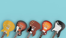 Collection Of Guitars On A Blue Background.