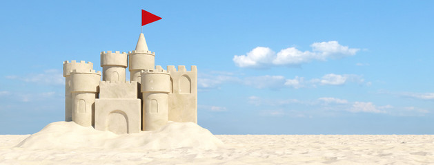 Sandcastle on the beach with sand in summer