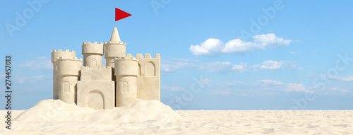 Fototapeta Sandcastle on the beach with sand in summer obraz