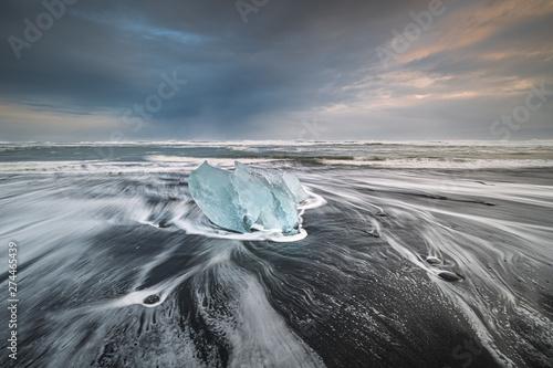 Foto auf Leinwand Rosa dunkel Iceland landscape black beach girl rocks diamonds ice iceberg