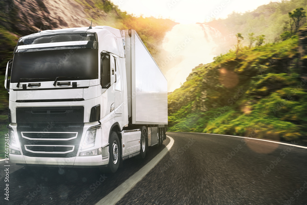 Fototapety, obrazy: White truck moving on the road in a natural landscape at sunset