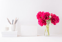 Mockup White Desk Calendar And Red Peonies In A Vase On A White Table