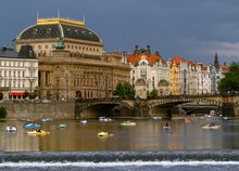 PRAGUE, CZECH REPUBLIC. On June 20, 2019. View Beautiful Prague National Theatre  Along The River Vltava  By Which They Ride Boats And Catamarans. European Travel.