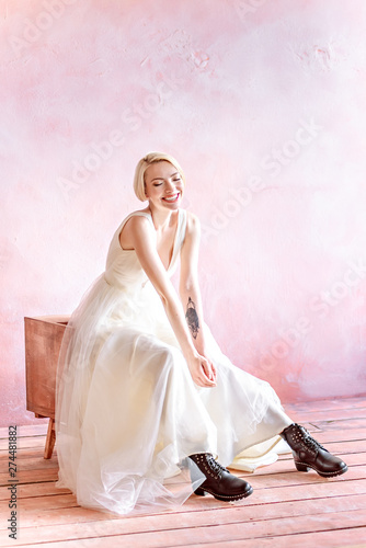 Fashionable and beautiful bride with a short haircut and an incredible smile. The image of the bride in the trend of this year.