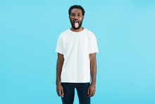 Handsome African American Man Sticking Tongue Out Isolated On Blue