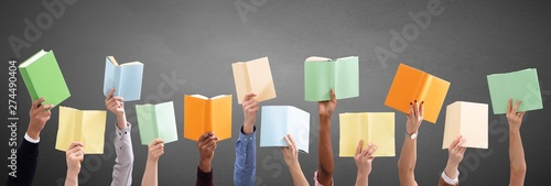 Poster Individuel Hands Holding Different Books In Gray Background
