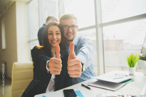 Businessman And Businesswoman Meeting In Modern Office with good, well sign by h Tableau sur Toile