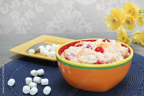 Photo Ambrosia salad of oranges, cherries, coconut and marshmallows.